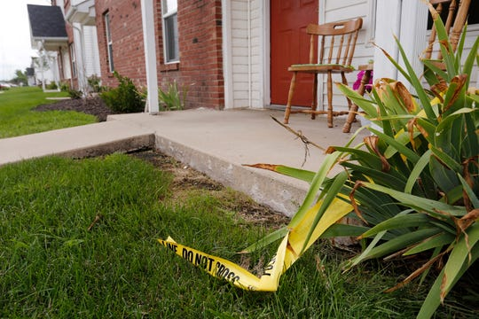 Police tape still remains in the area following the discovery of the body of 16-year-old Keiandre Holt at 7 a.m. Tuesday at the Cross Point Apartments in the 3900 block of Ameilia Avenue in Lafayette. The boy's body was found in front of the porch in the background on the left.