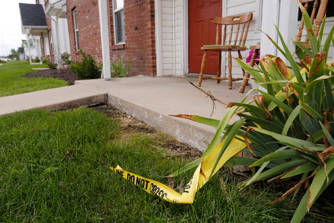 Police tape still remains in the area following the discovery of the body of a 15-year-old male at 7 a.m. Tuesday, August 21, 2018, at the Cross Point Apartments in the 3900 block of Amelia Avenue in Lafayette.