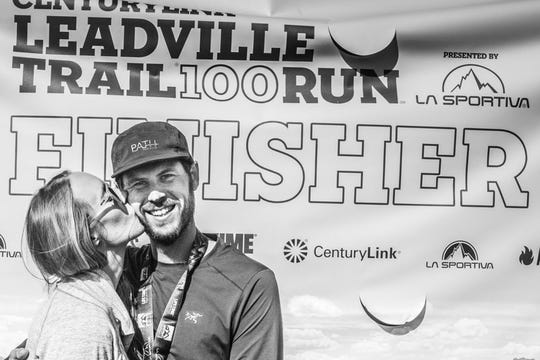 Jason Cohen gets a kiss from wife Jen after finishing the Leadville 100, a 100-mile trail run across mountains in Leadville, Colorado, Aug. 18-19. He finished in 29 hours 25 minutes and 52 seconds.