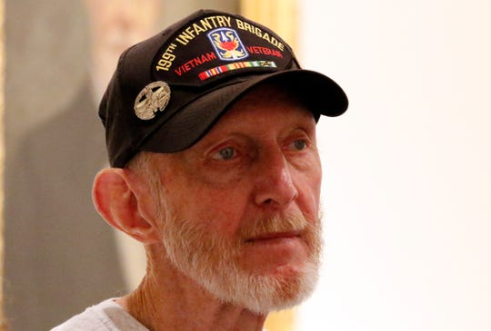 Ric Hurst, from Sugar Grove, listens to Karen Wagner as she leads Hurst and other Vietnam veterans on a tour of the Sherman House Tuesday morning, Aug. 21, 2018, in downtown Lancaster. Hurst and the other veterans on the tour served together in Vietnam and have gathered once a year for the past 15 years at different locations throughout the country.