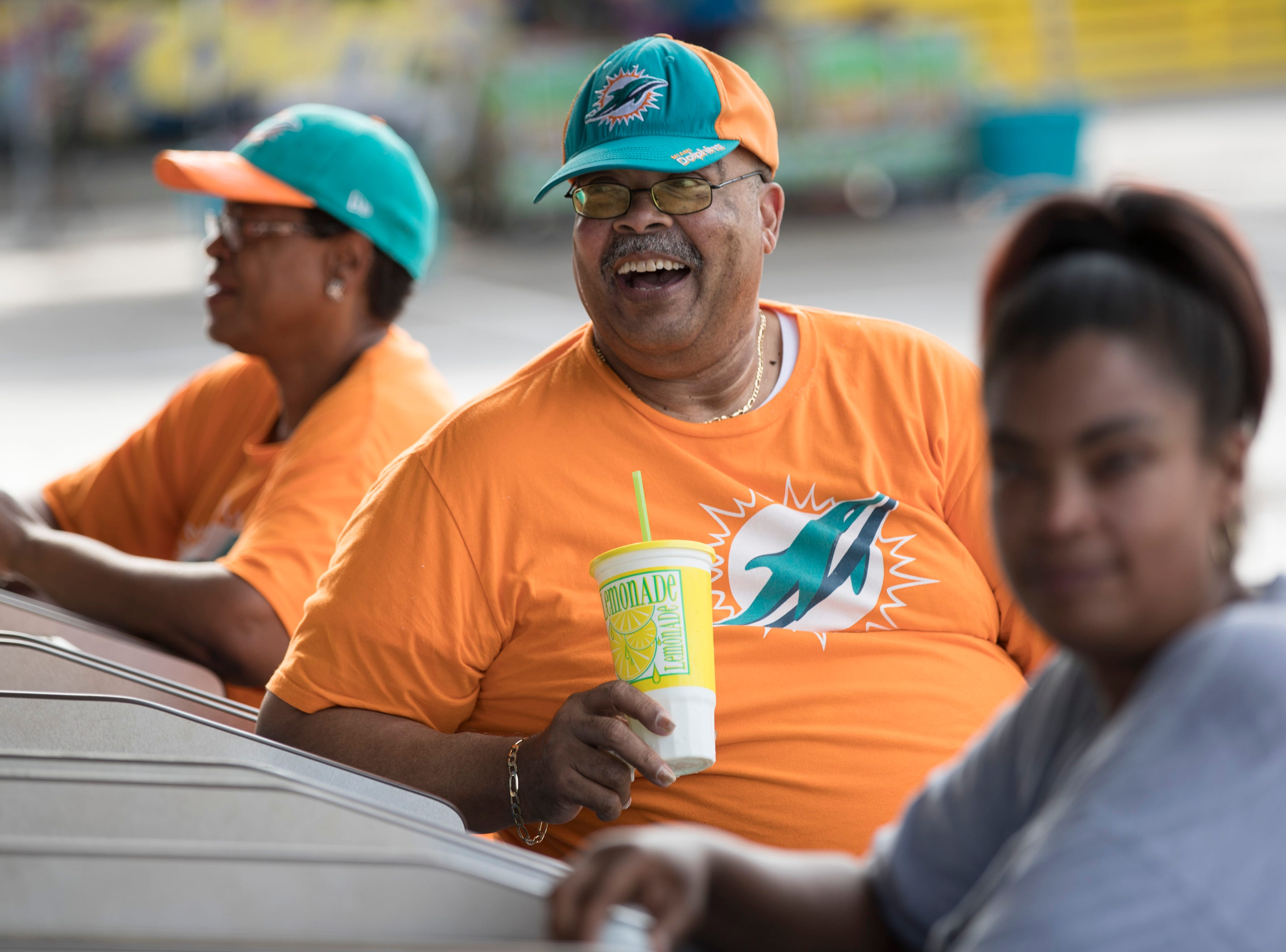 Willie Parker, center, the father of former U of L and Miami Dolphins' wide receiver DeVantae Parker, has a laugh with family at the Kentucky State Fair on Monday. Aug. 20, 2018