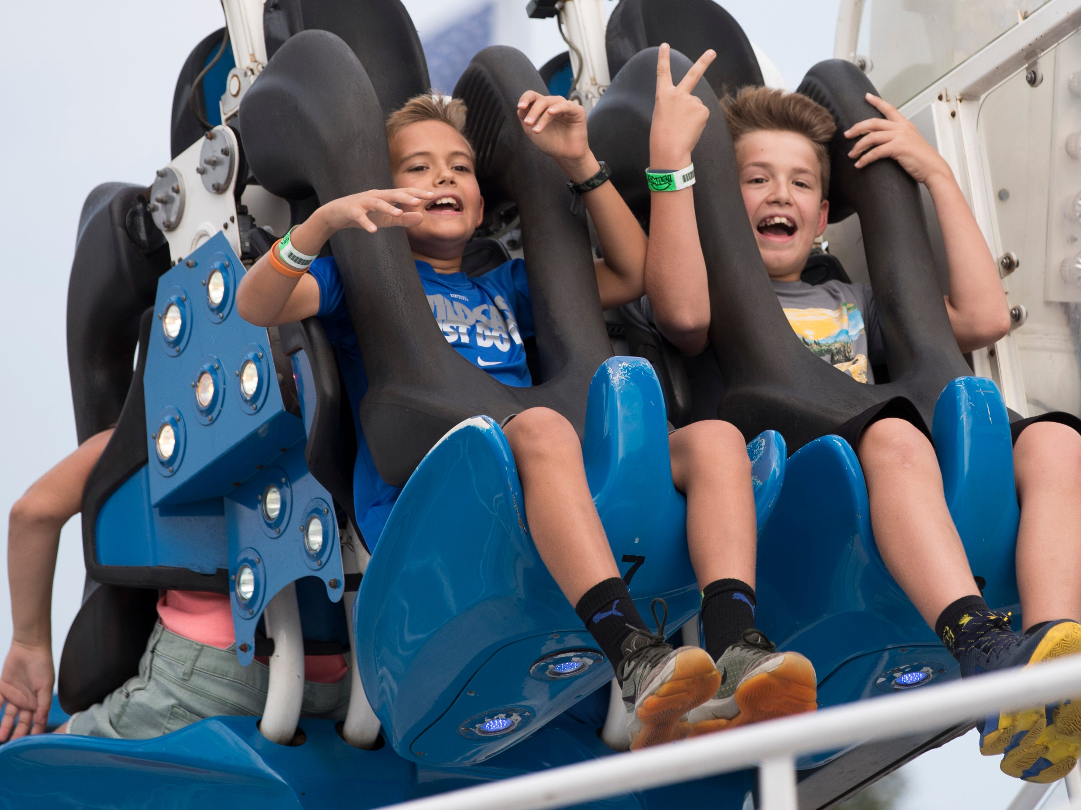 Evan Callaway, left, and brother Chase Callaway ride on Speed at the Kentucky State Fair on Monday. Aug. 20, 2018