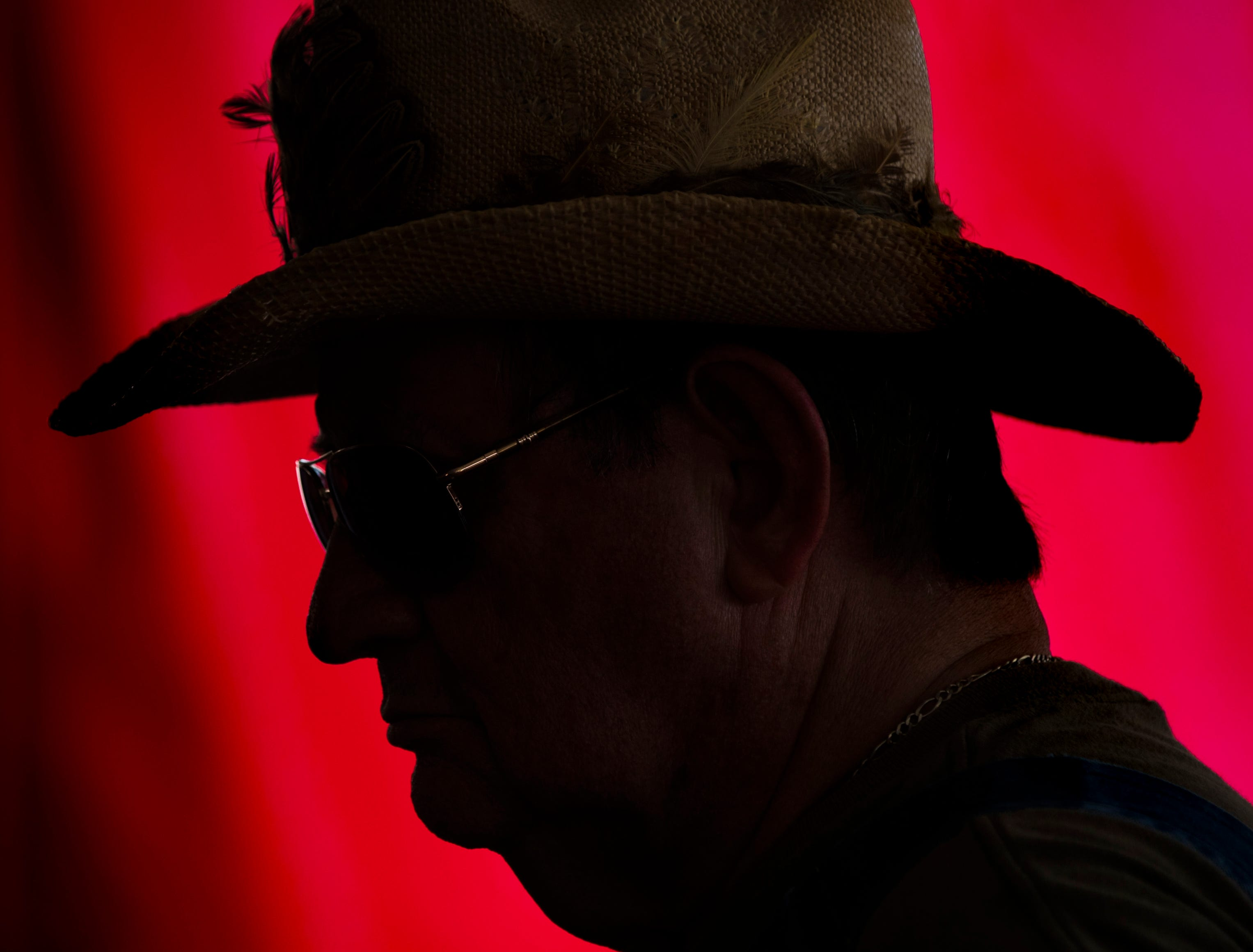 John Mullins sits in the shade to take in some country music at the Kentucky State Fair on Monday. Mullins attends the fair each year and enters artwork and paintings. Aug. 20, 2018