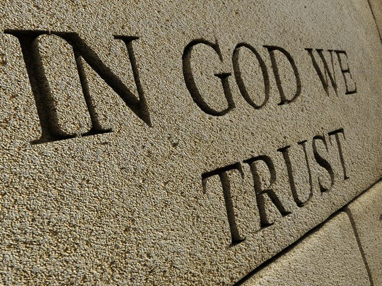 """Gov. Kristi Noem signed into law last month a bill that requires public schools to prominently display the national motto, """"In God We Trust,"""" starting in 2019-20."""