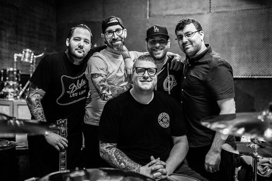The Ghost Inside on April 30, when the band played music together for the first time since a devastating crash in 2015. Pictured left to right is Zach Johnson, Jim Riley, Andrew Tkaczyk, Jonathan Vigil and Chris Davis.