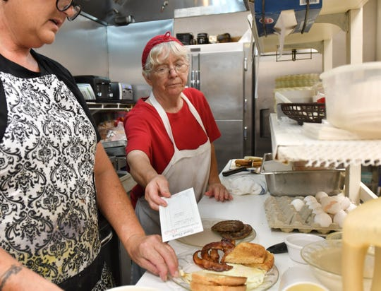 Trudy Breysse, right, worked at Mike's Village Restaurant for 43 years prior to its closing.  She is now the baker and a cook at the newly-opened MorningLory Cafe & Bakery in downtown Dimondale.
