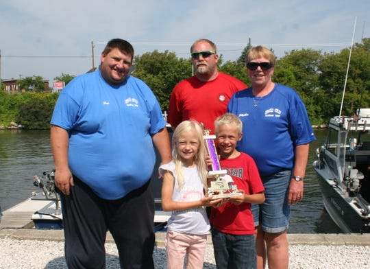 """Crew of the boat """"Bubba Gump,"""" captained by Patrick NienhauswithLittle Sister Gracelynn and her brother Jayden holding the trophy for the biggest catch."""