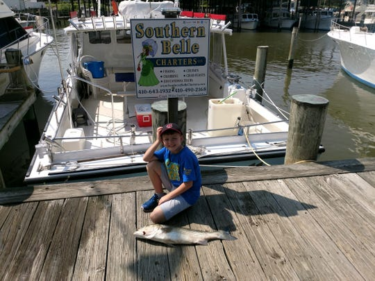 Liam Young poses with a fish he caught during a recent trip to Chesapeake Bay provided by the Casey Cares Foundation.