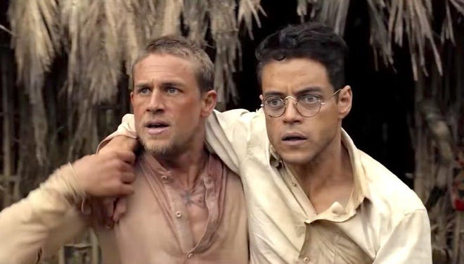 "Charlie Hunnam and Rami Malik take the Steve McQueen and Dustin Hoffman roles in a remake of the intense prison movie, ""Papillon."""
