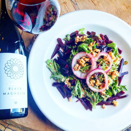 Pinot Noir is a good choice to go along with salads such as this dish from Wine Maniacs featuring mixed greens, beets, onions, carrots and walnuts with a cherry maple vinaigrette.