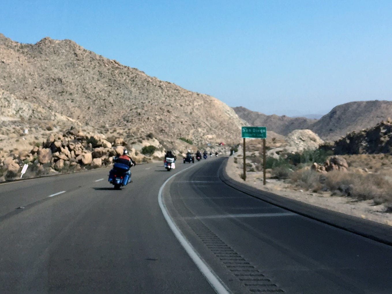 Riders curve along a stretch of I-8 East on the edge of San Diego County.