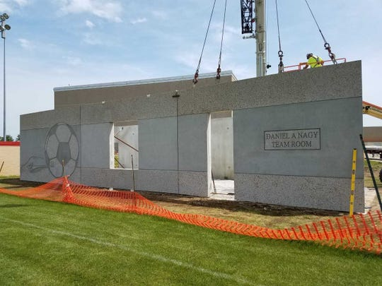 The walls are being put into place for the Daniel A. Nagy Team Room, a space for the Arrowhead High School boys and girls soccer teams to store equipment, change and hold halftime locker room talks.