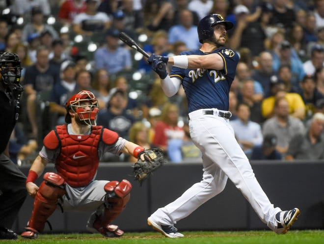 Travis Shaw hits a two-run homer in the sixth inning to put the Brewers ahead to stay against the Reds on Monday night.