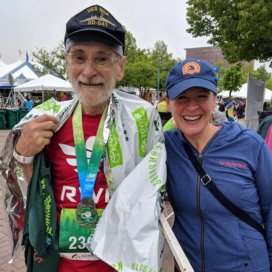 John Lunz, 80, with his daughter Ruth, after he ran Grandma's Marathon in June of 2018.