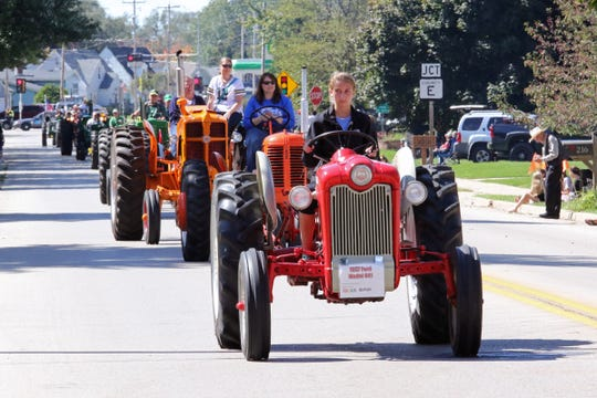 A long line of tractors parades through North Prairie during a past Harvest Festival.
