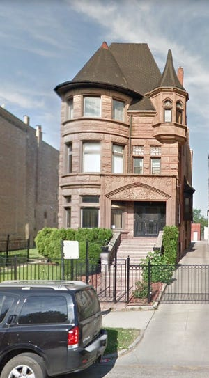 Federal prosecutors say this house on Chicago's near south side was purchased by a Milwaukee man who bought it with money scammed from the IRS.