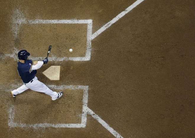 Milwaukee Brewers' Travis Shaw hits a two-run home run during the sixth inning of a baseball game against the Cincinnati Reds Monday, Aug. 20, 2018, in Milwaukee. (AP Photo/Morry Gash) ORG XMIT: WIMG111