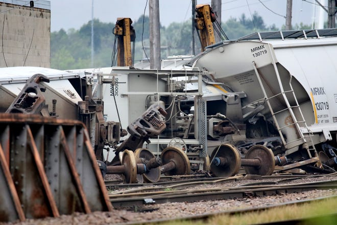 Union Pacific Railroad crew began cleanup and track repair from 13 empty bulk storage container cars that derailed, eight laying on their sides, south of Capitol Drive and west of I-41 at about 10 p.m. Aug. 20.