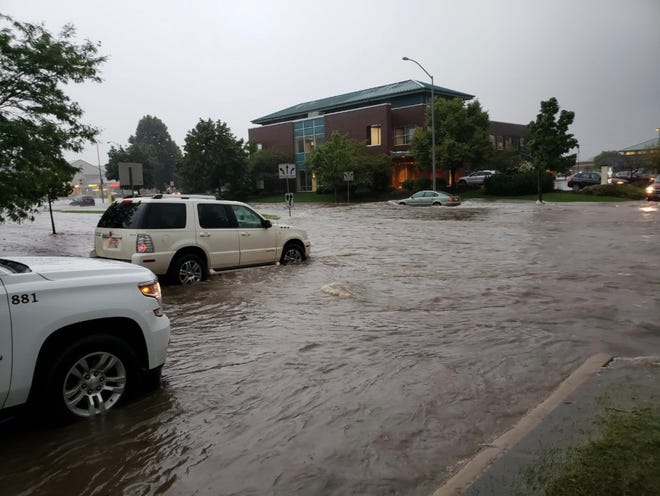 North High Point Road, Madison, outside the Alicia Ashman Library is flooded.