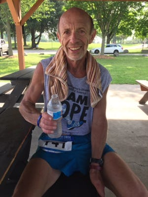 Jim Christus competes at least once a month in a run despite the physical and mental challenges he faces from Huntington's disease.