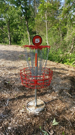 A view of the basket at the fifth hole at the Denoon Park disc golf course in Muskego. A similar basket was recently stolen from the seventh hole at the course, which opened in June.