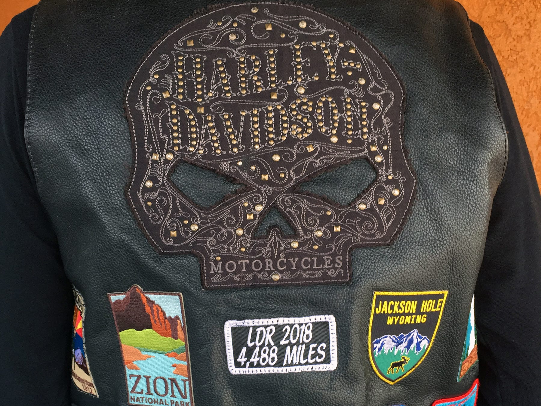 The badges on the back of Pamela Barnett's jacket represent a 5,000-mile, 16-day trip she and her friend Harri Fenske took in June. They went through California, Oregon, Washington, Wyoming, Montana, Idaho and Utah.