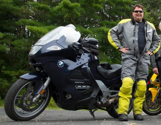 Milwaukee Journal Sentinel photojournalist Mark Hoffman rides his motorcycle near Ontario, Wisconsin.