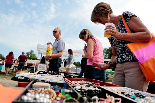 Judy Abel looks through merchandise at one of the vendor's booths at a past Cedarburg Maxwell Street Days. The market returns Sunday, Sept. 2.