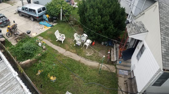 The backyard of Richard Krzywkowski's home on Aug. 20 when he was to have everything cleaned up. Neighbor Dustin Jablonski said it didn't appear he made much progress but the food appeared to be gone.