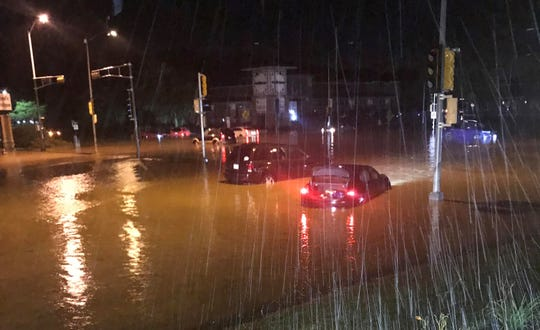 Motorists are stuck in flooded streets Monday night near University Avenue and Midvale Boulevard in Madison.