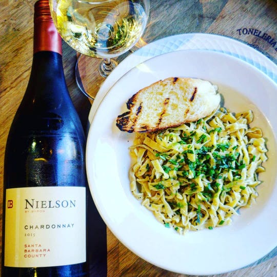 Chardonnay can go well with many things including lighter pasta dishes such as this butter sauteed pasta with fresh garlic chives and thyme from Wine Maniacs Wine Bar & Bistro.