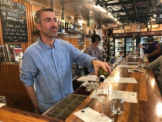 Thief Wine owner Phil Bilodeau pours a glass at Thief's downtown location in the Milwaukee Public Market. The company also has a store in Shorewood.
