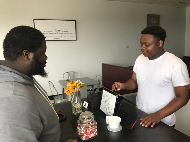 Andre Horton (right) opened Arlanderz in Menomonee Falls last month. The 23-year-old is a Milwaukee native.