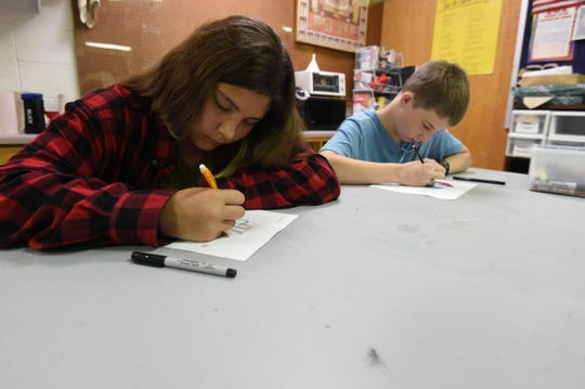 Norfork High School eighth graders Alisha Arroyo, left, and Daniel Smith work on drawings Tuesday during an Art class. Classes such as Art are important in helping develop well rounded students who can be successful later in life, the district's principals say.
