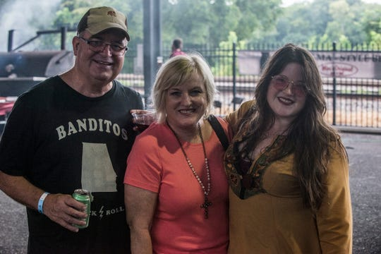 Mary Beth Richardson, singer with the band Banditos, with her parents from Birmingham. Hog Days of Summer returned for its second year at the Union Station Train Shed in Montgomery on Saturday, Aug. 18, 2018.