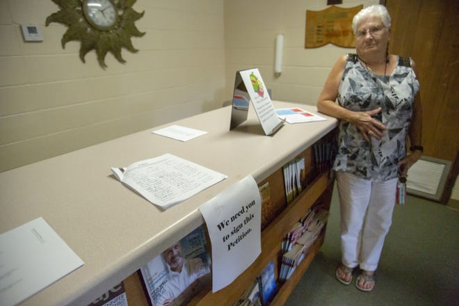 Betty Brown stands near a petition, left at Catoma Baptist Church, for parishioners to sign and express their discontent with a proposed liquor license application.