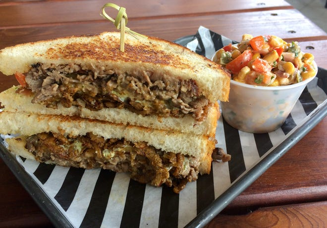 """""""Raise Up Roast Beef """" sandwich with side of charred corn salad at Holler & Dash Biscuit House."""