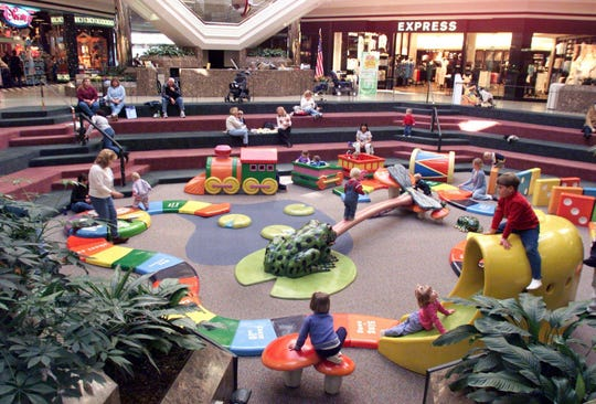 Bellevue Center's play area in the middle of the mall was a popular place for parents and their kids in 2002.