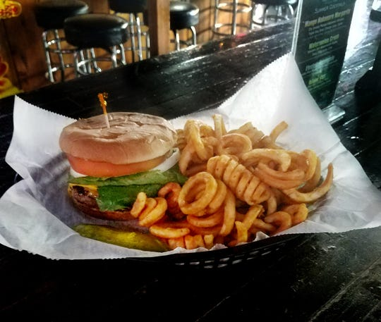 The Neighbors cheeseburger is just $7, with a side and drink, on weekdays at lunch.