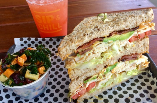 """The """"Smokin' Turkey Club"""" with roasted sweet potato salad at Holler & Dash Biscuit House."""