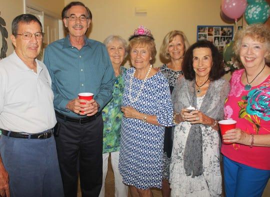 John Moore, Bill King, Dottie Henderson, MaryAnn Cassidy, Betty Muskus, Jean King and Cathy Mendygraw enjoy the party.