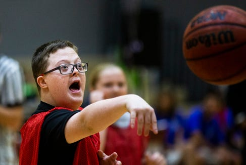 Parker Seward passes the ball during an all-star basketball game featuring the junior high girls team and the STARability Foundation team at First Baptist Academy in Naples on Friday, August 17, 2018.