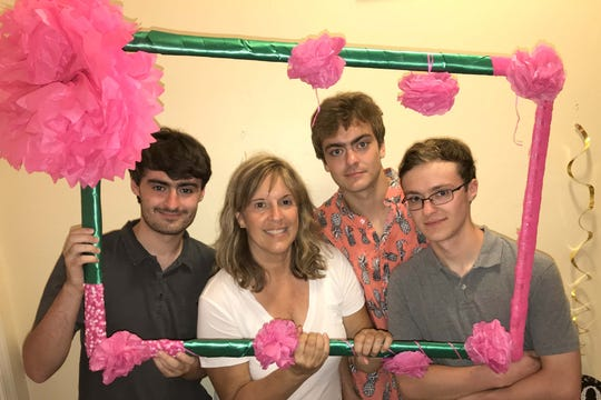 Linda Meere is framed by by her sons Josh, Joey and Jason.