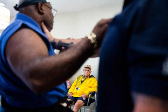 William Reinckens watches as instructor Otis Dykes demonstrates how to break a hold during a self-defense class for seniors at American House Senior Living Coconut Point in Estero on Tuesday, August 21, 2018.