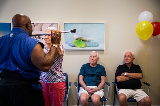 Bob Martin, from right, and Dave Dickerman watch as Betty Dickerman practices uses a cane as a weapon against instructor Otis Dykes during a self-defense class at American House Senior Living Coconut Point in Estero on Tuesday, August 21, 2018.