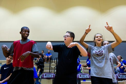 Sage Jacobs, from left, Parker Seward and Mollie Haskins cheer for their team during an all-star basketball game featuring the junior high girls team and the STARability Foundation team at First Baptist Academy in Naples on Friday, August 17, 2018.