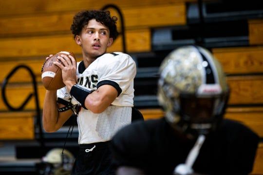 Junior Ryan Magel runs a quarterback drill during football practice at Golden Gate High School on Monday, August 20, 2018.