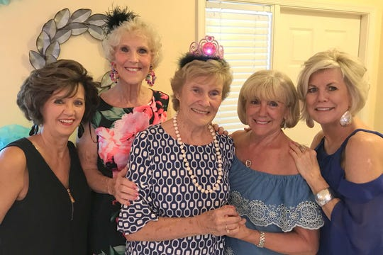 Candy Seward, Susie Walsh, MaryAnn Cassidy, Betsy Zinner and Sharon Cook celebrate friendship and birthday.