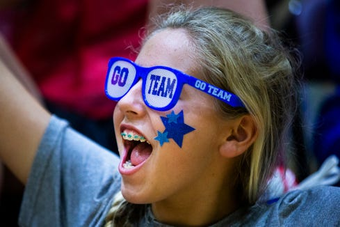 Gracie Raymer cheers for her team during an all-star basketball game featuring the junior high girls team and the STARability Foundation team at First Baptist Academy in Naples on Friday, August 17, 2018.