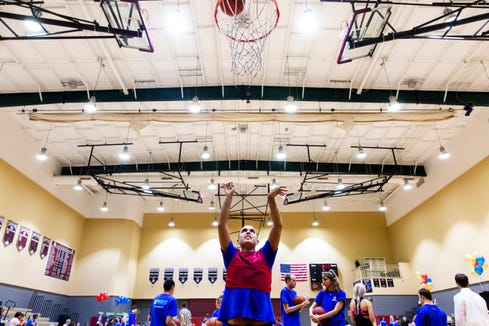 Michael Presto shoots the ball during warm-ups before an all-star basketball game featuring the junior high girls team and the STARability Foundation team at First Baptist Academy in Naples on Friday, August 17, 2018.